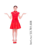 Купить «Young asian woman in red cheongsam with gesture in chinese new year», фото № 33781608, снято 14 июля 2020 г. (c) age Fotostock / Фотобанк Лори