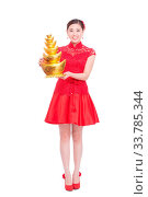 Купить «Young asian woman in red cheongsam holds gold ingot in chinese new year», фото № 33785344, снято 14 июля 2020 г. (c) age Fotostock / Фотобанк Лори