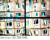 Купить «Crooked reflection of houses in the glass of the window abstract colored background», фото № 33789540, снято 31 мая 2020 г. (c) easy Fotostock / Фотобанк Лори