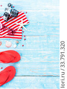 Купить «Red Summer background with camera starfish sandle sunglasses on blue wooden table background with copy space», фото № 33791320, снято 3 июля 2020 г. (c) easy Fotostock / Фотобанк Лори