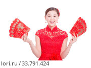 Купить «Young asian woman in red cheongsam holds red envelope in chinese new year», фото № 33791424, снято 14 июля 2020 г. (c) age Fotostock / Фотобанк Лори
