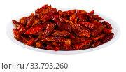 Купить «Dried cayenne peppers in bowl», фото № 33793260, снято 23 мая 2020 г. (c) Яков Филимонов / Фотобанк Лори