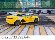Купить «Modern car of Yandex Taxi company in the parking lot on city street», фото № 33793644, снято 9 июля 2019 г. (c) FotograFF / Фотобанк Лори
