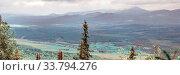 Купить «Nikolayevka village on the background in the Ural Mountains and taiga, in the distance one can see the mountain Iremel.», фото № 33794276, снято 8 сентября 2014 г. (c) Акиньшин Владимир / Фотобанк Лори