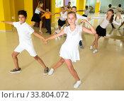 Boys and girls enjoying active dance. Стоковое фото, фотограф Яков Филимонов / Фотобанк Лори