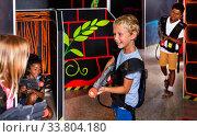 Купить «Preteen boy with laser pistol playing on labyrinth», фото № 33804180, снято 29 мая 2020 г. (c) Яков Филимонов / Фотобанк Лори