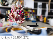 Workplace with spool of threads in sewing shop of variety clothes factory. Стоковое фото, фотограф Яков Филимонов / Фотобанк Лори