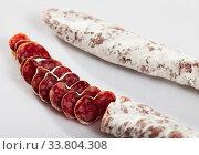 Sliced Catalan dry cured sausage Fuet. Стоковое фото, фотограф Яков Филимонов / Фотобанк Лори