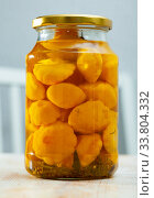 Pickled squash in glass jar on table at home kitchen. Стоковое фото, фотограф Яков Филимонов / Фотобанк Лори