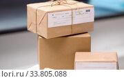 Купить «close up of parcel boxes at post office», видеоролик № 33805088, снято 2 июня 2020 г. (c) Syda Productions / Фотобанк Лори