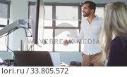 Купить «Businessman celebrating in modern office», видеоролик № 33805572, снято 12 октября 2019 г. (c) Wavebreak Media / Фотобанк Лори