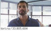 Купить «Businessman drinking coffee in modern office», видеоролик № 33805604, снято 12 октября 2019 г. (c) Wavebreak Media / Фотобанк Лори