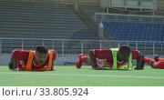 Купить «Hockey players preparing before a game», видеоролик № 33805924, снято 18 ноября 2019 г. (c) Wavebreak Media / Фотобанк Лори
