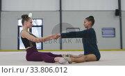 Купить «Female gymnasts performing at sports hall», видеоролик № 33806012, снято 17 сентября 2019 г. (c) Wavebreak Media / Фотобанк Лори