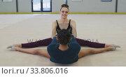 Купить «Female gymnasts performing at sports hall», видеоролик № 33806016, снято 17 сентября 2019 г. (c) Wavebreak Media / Фотобанк Лори