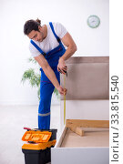 Купить «Young male contractor installing furniture at home», фото № 33815540, снято 11 ноября 2019 г. (c) Elnur / Фотобанк Лори