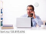 Купить «Young male employee working from house», фото № 33815616, снято 30 октября 2019 г. (c) Elnur / Фотобанк Лори