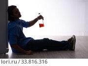 Купить «Young man suffering from alcoholism», фото № 33816316, снято 10 сентября 2019 г. (c) Elnur / Фотобанк Лори