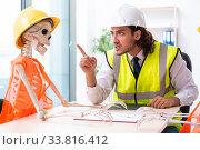 Купить «Funny construction business meeting with boss and skeletons», фото № 33816412, снято 27 августа 2019 г. (c) Elnur / Фотобанк Лори