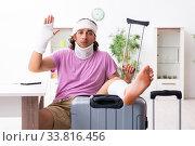 Young injured man preparing for the trip. Стоковое фото, фотограф Elnur / Фотобанк Лори