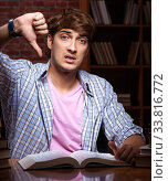 Купить «Young handsome student preparing for exams at night», фото № 33816772, снято 28 августа 2018 г. (c) Elnur / Фотобанк Лори