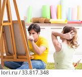 Купить «Young couple enjoying painting at home», фото № 33817348, снято 11 июля 2018 г. (c) Elnur / Фотобанк Лори
