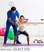 Купить «Fitness instructor helping sportsman during exercise», фото № 33817376, снято 10 июля 2018 г. (c) Elnur / Фотобанк Лори