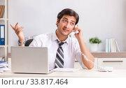 Купить «Young call center operator speaking on phone», фото № 33817464, снято 3 июля 2018 г. (c) Elnur / Фотобанк Лори