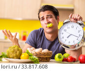 Купить «Young man in dieting and healthy eating concept», фото № 33817608, снято 19 июня 2018 г. (c) Elnur / Фотобанк Лори