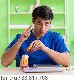 Купить «Dentist doctor working in the clinic», фото № 33817708, снято 28 мая 2018 г. (c) Elnur / Фотобанк Лори