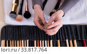 Купить «Make-up artist preparing brushes for work», фото № 33817764, снято 20 февраля 2018 г. (c) Elnur / Фотобанк Лори