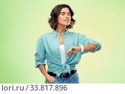 smiling young woman with smart watch breathing. Стоковое фото, фотограф Syda Productions / Фотобанк Лори