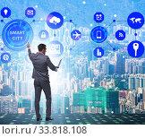 Купить «Concept of smart city with businessman pressing buttons», фото № 33818108, снято 1 июня 2020 г. (c) Elnur / Фотобанк Лори