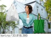 Купить «woman with plastic and reusable shopping bag», фото № 33818380, снято 18 апреля 2020 г. (c) Syda Productions / Фотобанк Лори
