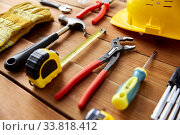 Купить «different work tools on wooden boards», фото № 33818412, снято 26 ноября 2019 г. (c) Syda Productions / Фотобанк Лори