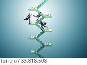 Купить «Businessman climbing stairs on yearly basis», фото № 33818508, снято 4 июня 2020 г. (c) Elnur / Фотобанк Лори
