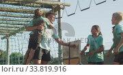 Купить «Group of Caucasian children training at boot camp », видеоролик № 33819916, снято 7 февраля 2020 г. (c) Wavebreak Media / Фотобанк Лори