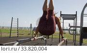 Купить «Sporty Caucasian woman exercising in an outdoor gym during daytime», видеоролик № 33820004, снято 8 августа 2019 г. (c) Wavebreak Media / Фотобанк Лори