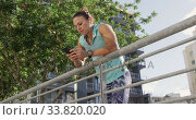 Купить «Sporty Caucasian woman exercising outdoor on a bridge», видеоролик № 33820020, снято 8 августа 2019 г. (c) Wavebreak Media / Фотобанк Лори