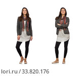 Купить «Girl in gray jacket isolated on white», фото № 33820176, снято 11 октября 2014 г. (c) Elnur / Фотобанк Лори