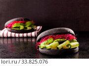 Купить «Healthy black vegan hamburgers on dark background.», фото № 33825076, снято 30 мая 2020 г. (c) easy Fotostock / Фотобанк Лори