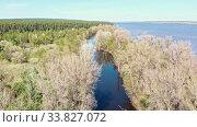 Купить «View of the river between the field with different trees», видеоролик № 33827072, снято 2 июня 2020 г. (c) Константин Шишкин / Фотобанк Лори