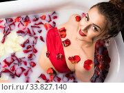 Купить «Brunette in red bikini in bath high angle shot», фото № 33827140, снято 15 мая 2020 г. (c) Гурьянов Андрей / Фотобанк Лори