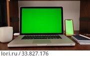 Купить «laptop computer with a key green screen set on work home office table», видеоролик № 33827176, снято 15 апреля 2020 г. (c) Ekaterina Demidova / Фотобанк Лори