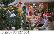 Купить «Happy big family celebrates Christmas», видеоролик № 33827364, снято 11 июля 2020 г. (c) Яков Филимонов / Фотобанк Лори