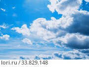 Голубое небо. Dramatic blue sky background. Picturesque colorful clouds lit by sunlight. Стоковое фото, фотограф Зезелина Марина / Фотобанк Лори
