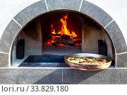 Купить «Cooking delicious pies in a Russian oven», фото № 33829180, снято 5 октября 2019 г. (c) FotograFF / Фотобанк Лори