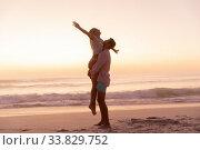Купить «Caucasian couple enjoying time at the beach during the sunset», фото № 33829752, снято 25 февраля 2020 г. (c) Wavebreak Media / Фотобанк Лори