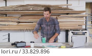 Купить «Caucasian male surfboard makers working in his studio», видеоролик № 33829896, снято 6 марта 2020 г. (c) Wavebreak Media / Фотобанк Лори