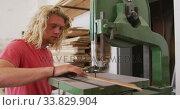 Купить «Caucasian male surfboard maker working in his studio and making a wooden surfboard», видеоролик № 33829904, снято 6 марта 2020 г. (c) Wavebreak Media / Фотобанк Лори